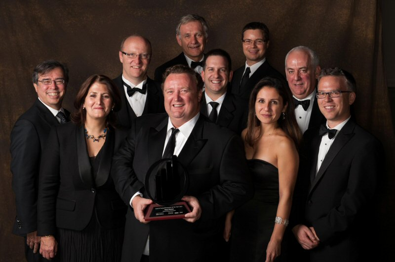 Sean Roosen (centre) surrounded by his team after winning the Entrepreneur of the Year Award in 2011 for Quebec (Photo: Osisko Mining)