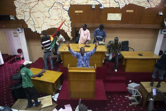 Anti-government protesters inside parliament before they set fire to it (Image: REUTERS/Joe Penney)