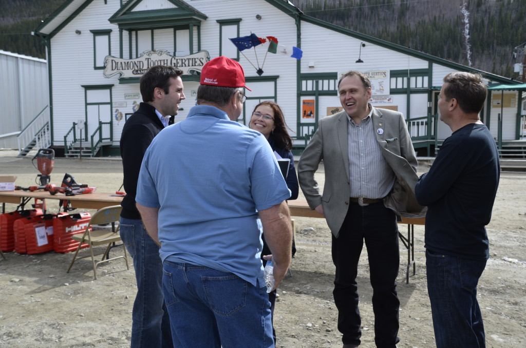 People in photo: Hon. Currie Dixon, Minister of Public Service Commission and Community Services. Tammie Pasloski, Premier's Wife. Hon. Darrell Pasloski, Yukon Premier Other two men are local exhibitors at the annual Dawson City Gold Show. Photo Credit: Government of Yukon