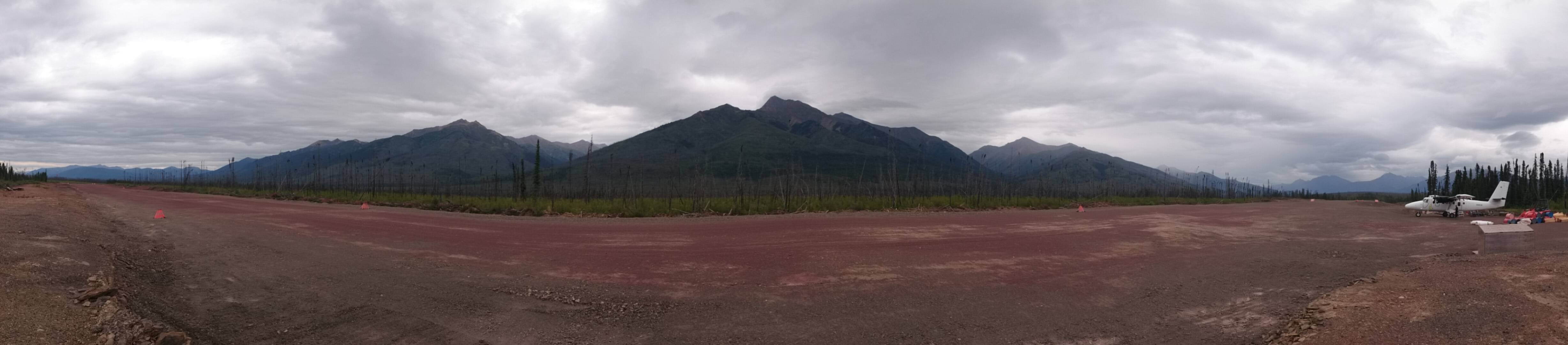 ATAC Resources 3000' Stewart Airstrip panorama. Background: The mountain valley to the left of the largest peak is the Nadaleen base camp for accessing the Osiris & Anubis Cluster.