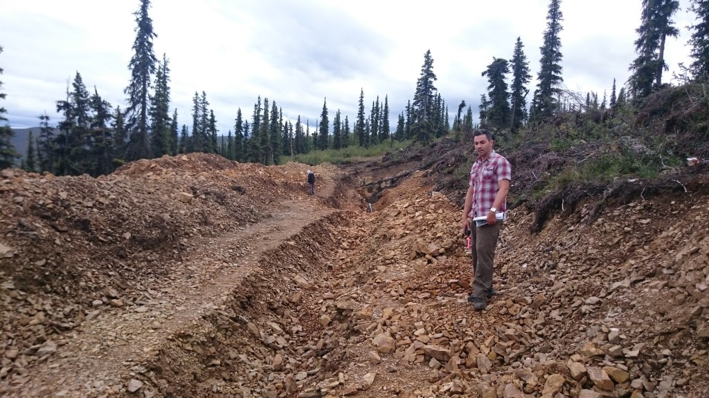 Mr. Reda, VP Corporate Development, has been on the project for over a decade. He explains to us how the gold bearing ore is in the orange-rusted rock in this trench.