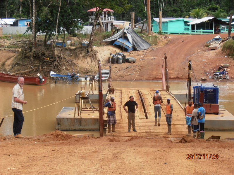 CEO Rich Munson crossing Sandspring's river pontoon in Guyana. Exploration manager, Pascal van Osta, is in the foreground. Munson still spends 7-10 days a month in country.